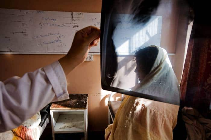 Aisha, who is nine months pregnant, was shot through the neck when fighting broke out in her village. Kate Holt.