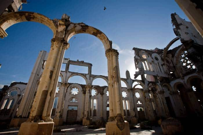 Birds fly over what remains of the Catholic Cathedral in downtown in Port au Prince. Kate Holt.