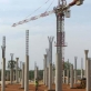 A crane and construction workers stand on the site of the new Juba Airport in Juba Southern Sudan. Kate Holt.
