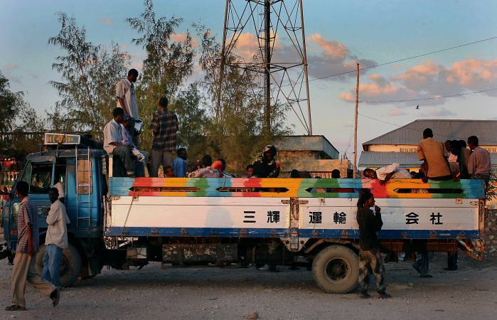 A truck loaded with people who are starting out on the long 700 km journey from Galkayo to Bosasso. Kate Holt.