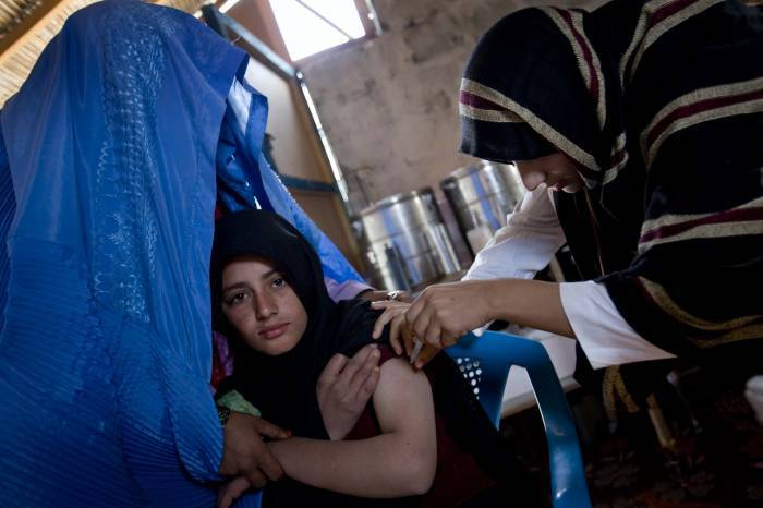 A 15 year old girl receives a tetanus injection prior to getting married. Kate Holt.