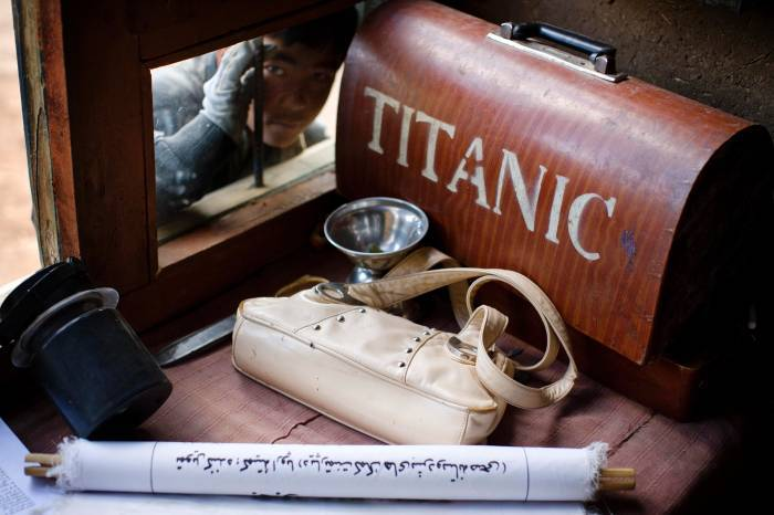 A sewing machine, marked with the words Titanic, sits in the corner of a room. Kate Holt.