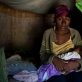 A woman holds her newborn baby at her home in the village of Androranga Vola in Madagascar. Kate Holt.