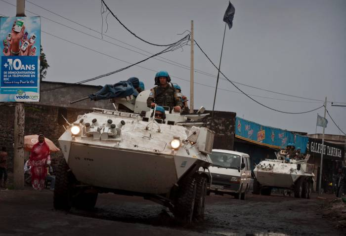 Peacekeepers from the UN force in the Congo - MONUSCO - patrol the streets of Goma. Kate Holt.