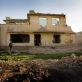 Men pray in the evening in the remains of a building that has been bombed in Kandahar. Kate Holt.