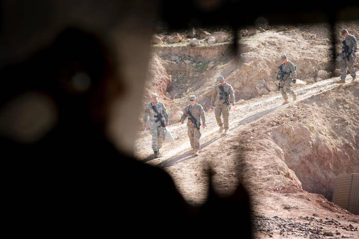 Soldiers from 2-508, of the 82nd Airborne Division of the US army walk down a hill at their base. Kate Holt.