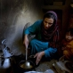 Simagul, a 30 year old woman from Loger, and 8 months pregnant with her 12th child. Kate Holt.