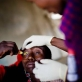 50 year old Seteiya Makoi has her bandages removed by Lester Moitai, a trachoma monitor. Kate Holt.