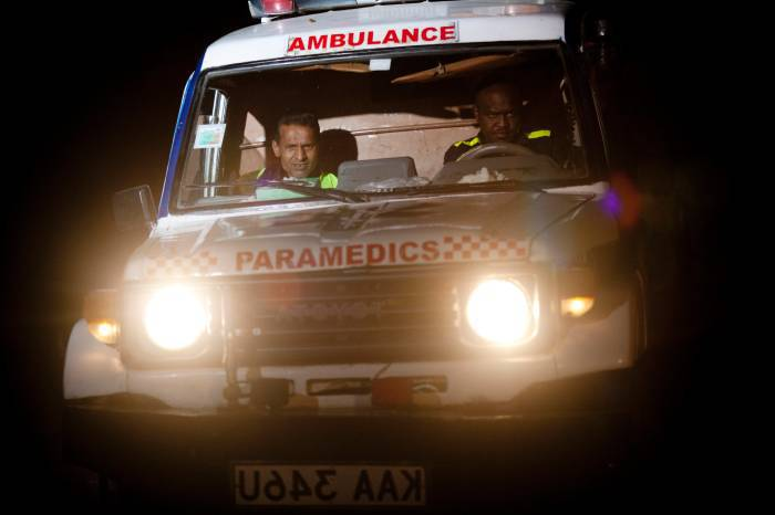 An ambulance drives through a security perimeter put into place a distance from the Westgate Shopping Centre. Kate Holt.