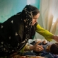 Zulmia sits with her eight year old son Mohammed who is in a coma after contracting meningitis. Kate Holt.