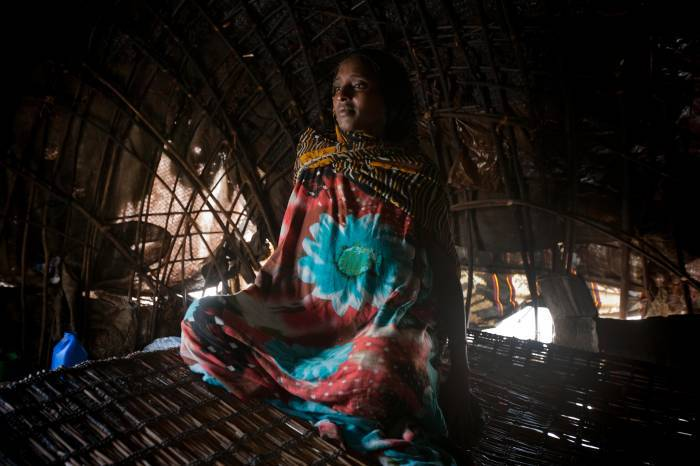A pregnant woman talks about her upcoming birth, near Logya, Ethiopia. Kate Holt.