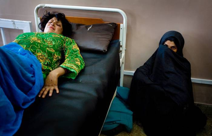 A woman in labour lies in labour in the obstetrics ward at Mirwais Hospital in Kandahar. Kate Holt.