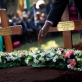 A pastor reads from the Bible at the burial of President Kenyatta's nephew Mbugua Mwangi. Kate Holt.