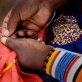 Lasoi Marangwai, 40 years old, and from the village of Koora, makes traditional Maasai Beadwork. Kate Holt.