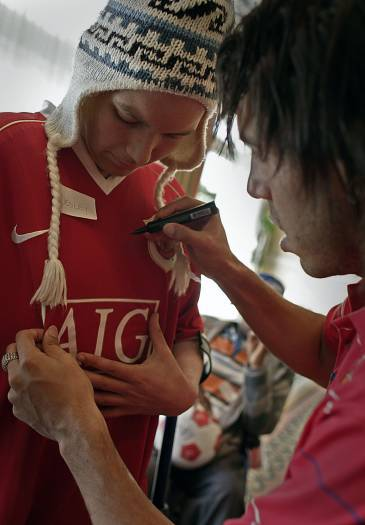 Carlos Tevez from Manchester United, signs the shirt of a young fan. Kate Holt.