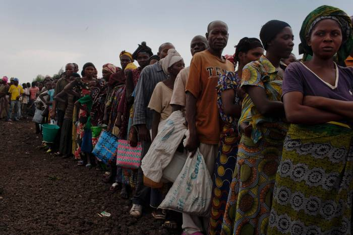 Families queue up to receive food rations at Munungi refugee camp in Goma. Kate Holt.