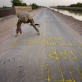 Lieutenant Alex Findlay, the RESA (Royal Engineer Search Adviser) spray paints the 300 m stretch of road. Kate Holt.