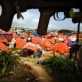 Orange plastic shelters, used as temporary accommodation by displaced people. Kate Holt.
