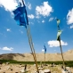 Flags blow in the wind at a graveyard near to the village of Foladia near Bamyan, Afghanistan. Kate Holt.
