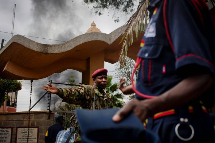 Police officers guard the edge of a security perimeter put into place a distance from the Westgate Shopping Centre in Nairobi. Kate Holt.