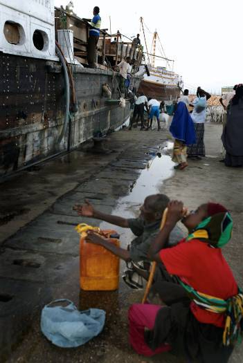 A Somali man and women beg at the port in Bosasso, Northern Somalia