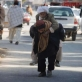A man carries an elderly man on his back to the Emergency Unit of Bost Hospital. Kate Holt.