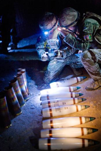 Soldiers from 4th Regiment the Royal Artillery prepares rounds of illuminators. Kate Holt.