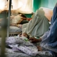 A woman, whose child is malnourished, waits in the therapeutic Feeding Unit. Kate Holt.