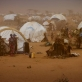 Newly arrived refugees from Somalia stand outside of their temporary homes at Dagehaley camp. Kate Holt.