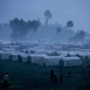 A camp for people displaced by recent fighting is photographed in the shadow of Nyragongo volcano in Kibati. Kate Holt.
