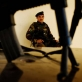 An Afghan Government Soldier sits guard outside of the office of the District Governor in Arghandab. Kate Holt.