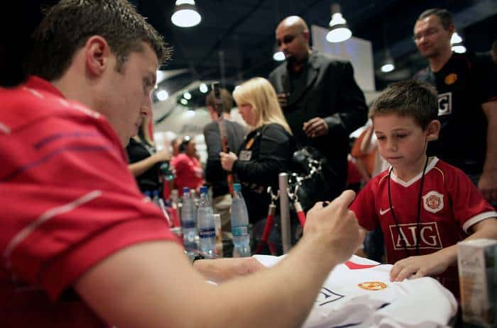 Michael Carrick signs Manchester United items for fans in a sports shop in a shopping centre in Cape Town. Kate Holt.