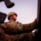 Sapper Steven Anderson, sits on top of a Danish Armored Vehicle. Kate Holt.