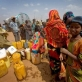 Newly arrived refugees from Somalia collect water at a water point. Kate Holt.