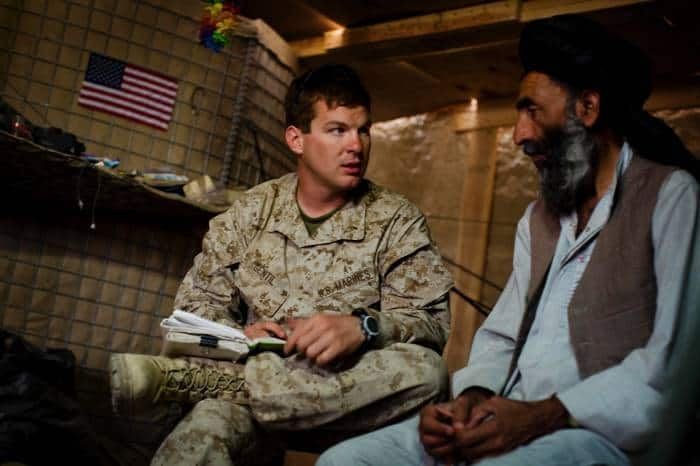 1st Lt Conner Gentil of 2/2 of the US Marines, discusses plans for local development with Haji Mohammed Zahir. Kate Holt.