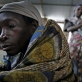 A woman who has been displaced by fighting near Kibumba, sits in a therapeutic feeding center. Kate Holt.