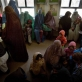 Children wait with their mothers to receive a vaccination in Bost Hospital. Kate Holt.