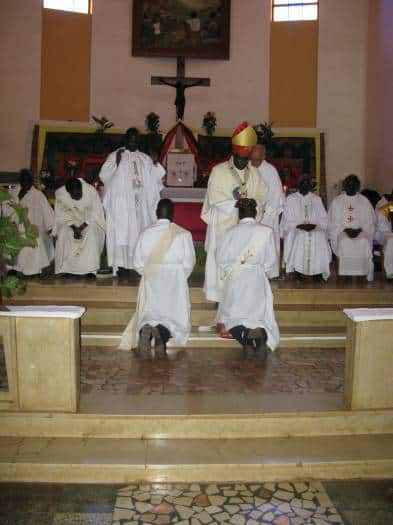 The Archbishop Paolino Lukudu Loro, head of the Archdiocese of Juba, ordains two deacons. Kate Holt.
