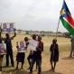 Street children hold photograph of the late Dr John Garang during a celebration of World Children's Day. Kate Holt.