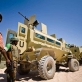 AMISOM soldiers stand next to their armored vehicles before heading out on patrol through the streets of Mogadishu. Kate Holt.