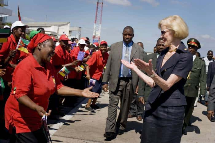 A dancer greets Quentin Bryce the Governor General of Australia on her departure from Maputo Airport. Kate Holt.