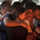 Ramesh Vaya is comforted by family members after lighting the funeral pyre for his wife, Malti. Kate Holt.