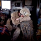 A US marine, who has been mentoring the training of Afghan National Army Soldiers sleeps on his rucksack in a helicopter. Kate Holt.