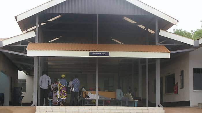 People wait in the newly built outpatients unit of Juba teaching Hospital. Kate Holt.