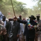 Salva Kiir Mayardit, the Vice President of the Sudan and President of South Sudan leads a crowd of people. Kate Holt.