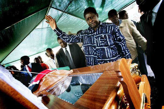 Raila Odinga, leader of Kenya's ODM opposition movement, bids farewell to ODM MP Mugabe Were. Kate Holt.