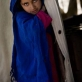 The neice of Sedamin poses for a photograph in her family's tent that is their home. Kate Holt.