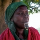 A woman sits smoking a pipe in Custom Market, Juba, Southern Sudan. Kate Holt.