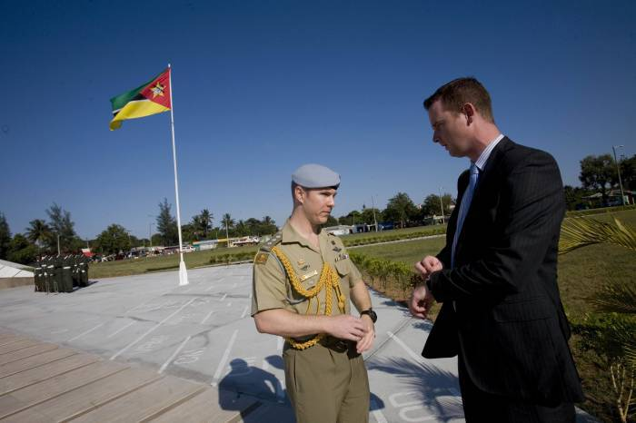 ADC Matthew Williams, and Paul Singer, Sr Logistics Adviser, awaits the arrival of the Governor General. Kate Holt.