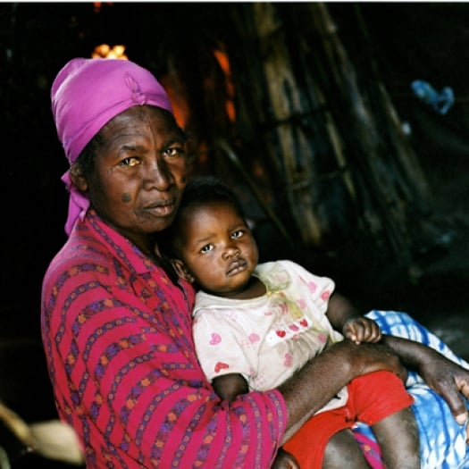 Angela Luanda with her grandchild lives in a camp for displaced people outside of Goma. Kate Holt.
